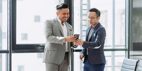 financial professional looking at phone with client